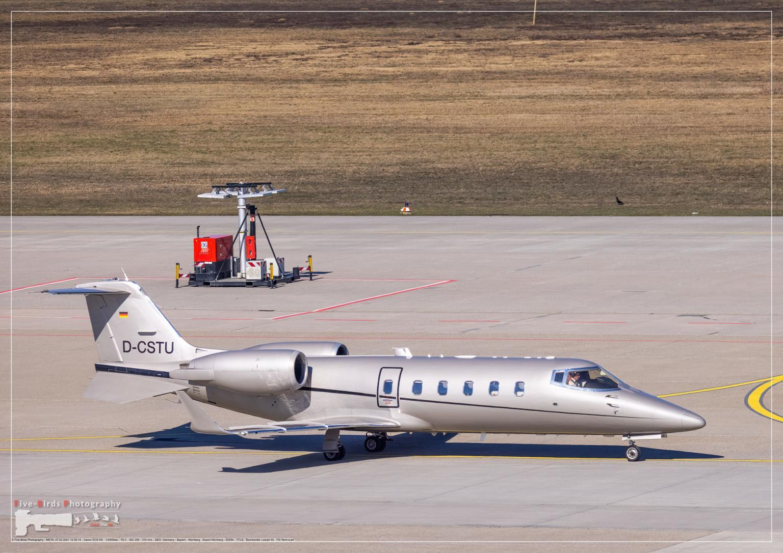A business Jet is taxiing to a runwy at the Albrecht Duerer Airport in Nuremberg