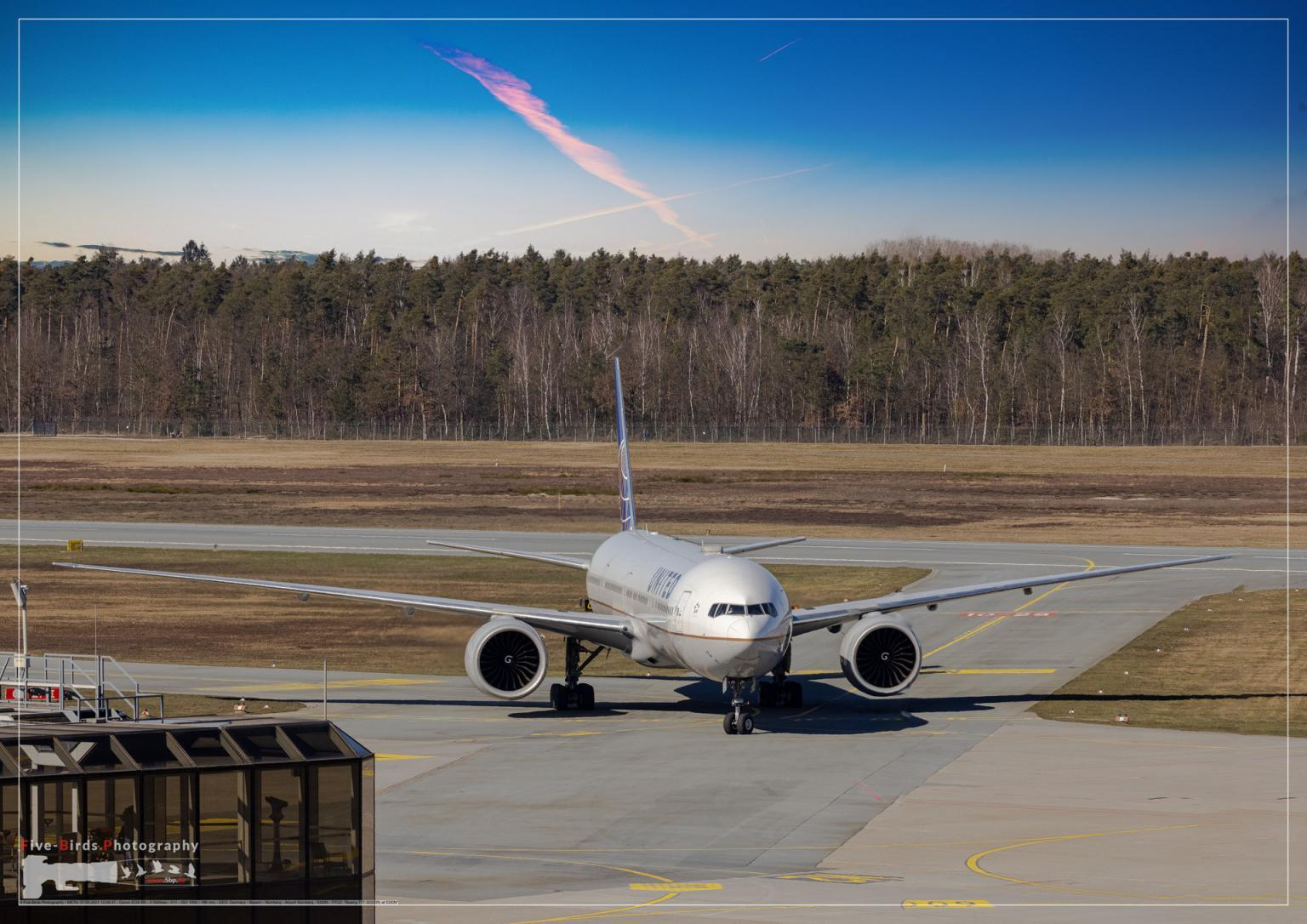 A wide body Jetliner delivering US Troops to Germany is taxiing to its standing position at the Albrecht Duerer Airport in Nuremberg in Germany