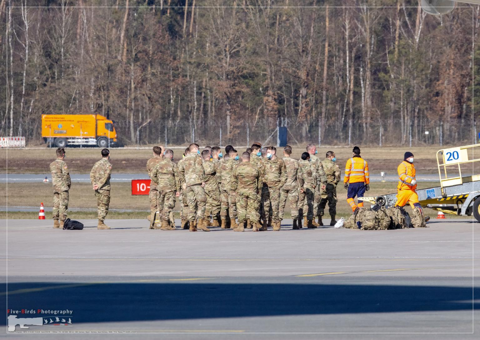 US troops are waiting after a special flight at the Albrecht Duerer Airport in Nuremberg in Germany